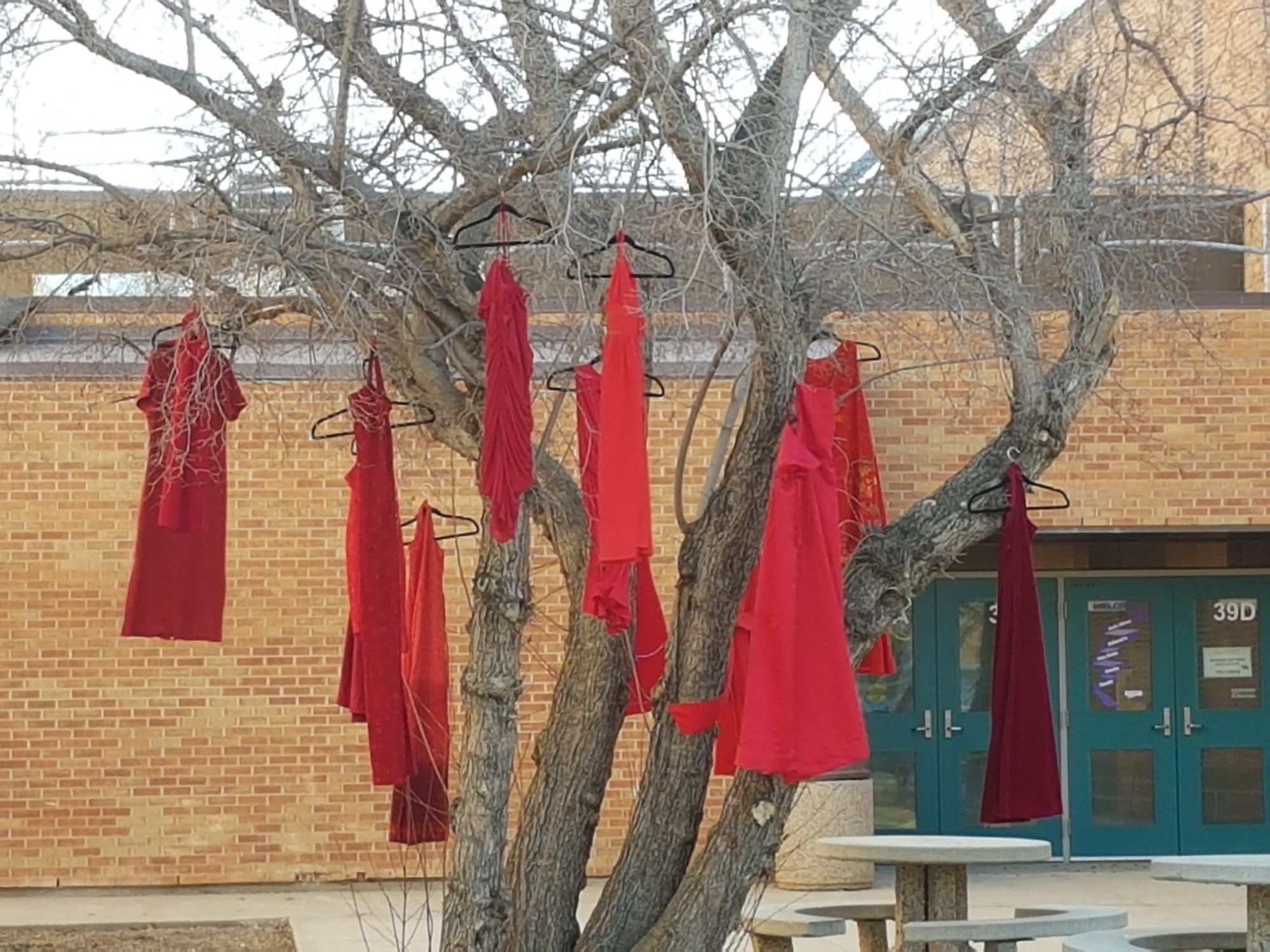 red dresses in tree